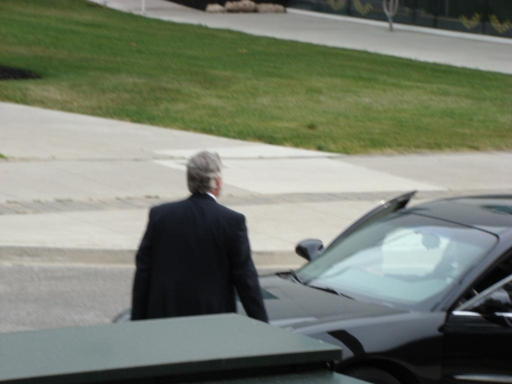 Hod's lawyer Andrew Bradie approaches car