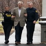 Father Labelle escorted out of coutrthouse